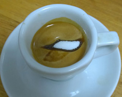 Sugar floats on perfect espresso